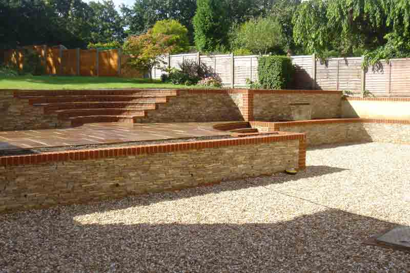 Surrey rear steps wall finish pc landscapes for Stepped garden designs