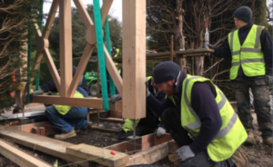 PC Landscape's installing the bespoke oak pergola at Exbury Gardens